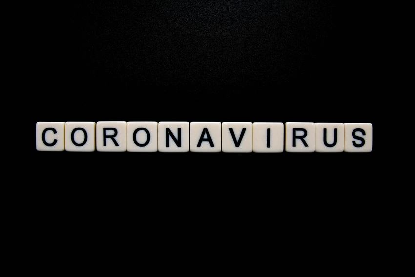 Coronavirus spelled out in tile letters against a black background